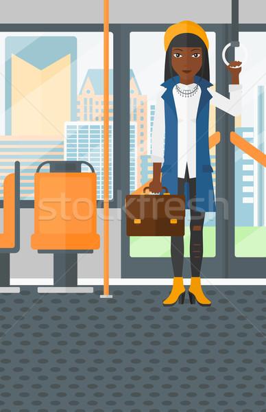 Kadın ayakta içinde toplu taşıma bavul vektör Stok fotoğraf © RAStudio