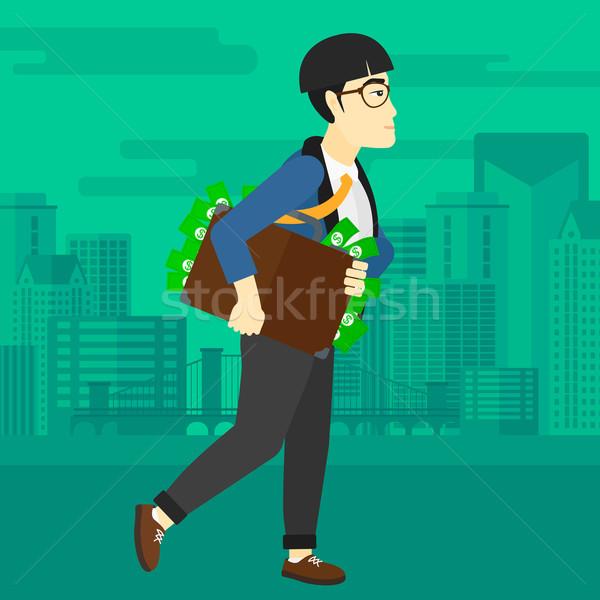 Man with suitcase full of money. Stock photo © RAStudio