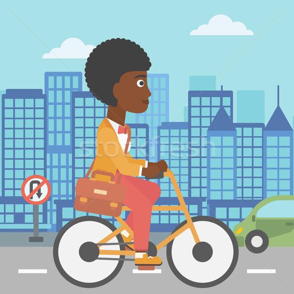 Nő biciklizik munka aktatáska város vektor Stock fotó © RAStudio