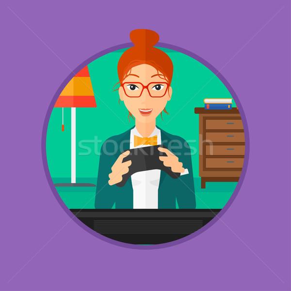 Femme jouer jeu vidéo heureux télévision excité Photo stock © RAStudio