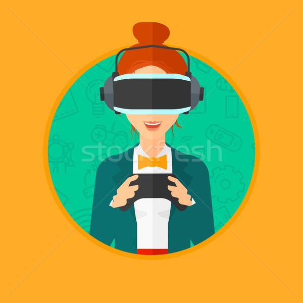 Woman wearing virtual reality headset. Stock photo © RAStudio