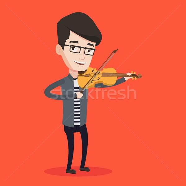 Stock fotó: Férfi · játszik · hegedű · fiatal · mosolyog · hegedűművész