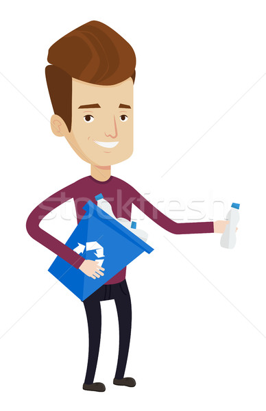 Man collecting garbage in recycle bin. Stock photo © RAStudio