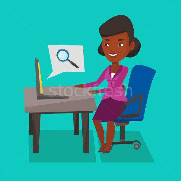 Business woman working on her laptop. Stock photo © RAStudio