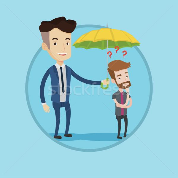Insurance agent holding umbrella over young man. Stock photo © RAStudio