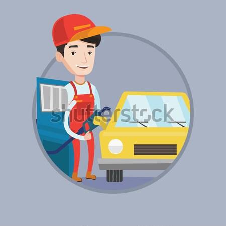 работник заполнение вверх топлива автомобилей АЗС Сток-фото © RAStudio