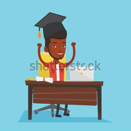 Diplomás laptopot használ oktatás ül asztal laptop Stock fotó © RAStudio
