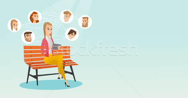 Woman surfing in the social network. Stock photo © RAStudio