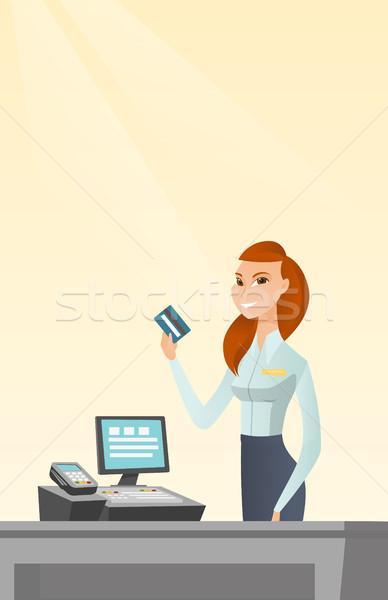 Caucasian cashier holding a credit card. Stock photo © RAStudio