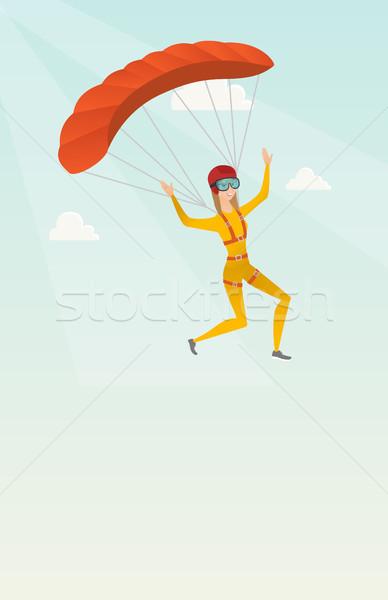 Jonge kaukasisch vliegen parachute gelukkig hemel Stockfoto © RAStudio