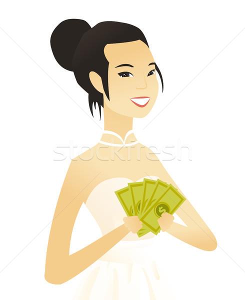 Jonge asian verloofde geld witte jurk Stockfoto © RAStudio