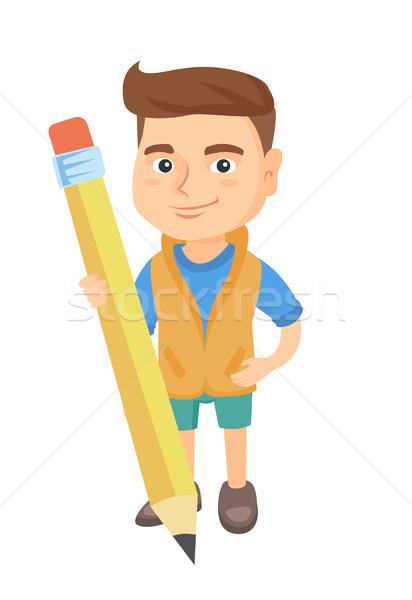 Caucasiano criança menino em pé enorme lápis Foto stock © RAStudio