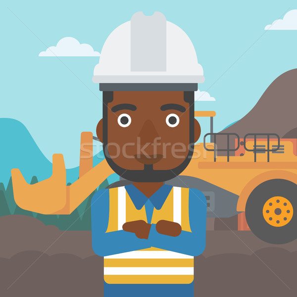Miner with mining equipment on background. Stock photo © RAStudio