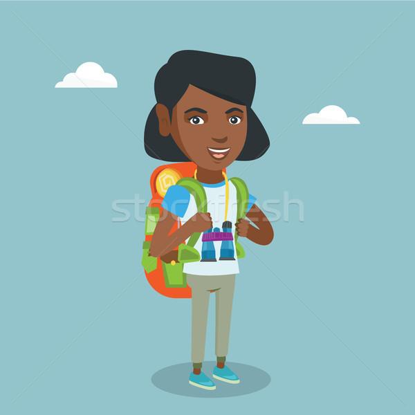 Jovem viajante mochila mulher em pé binóculo Foto stock © RAStudio