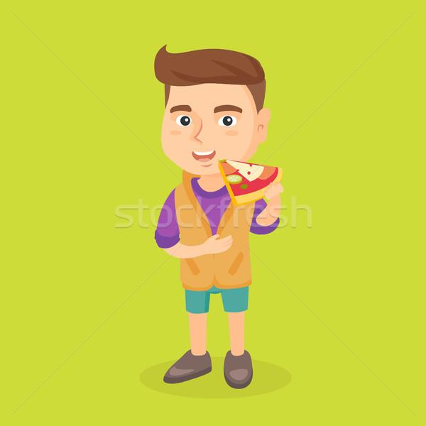 Caucasian boy eating tasty pizza. Stock photo © RAStudio