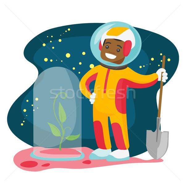 Astronaute arbre nouvelle planète Photo stock © RAStudio