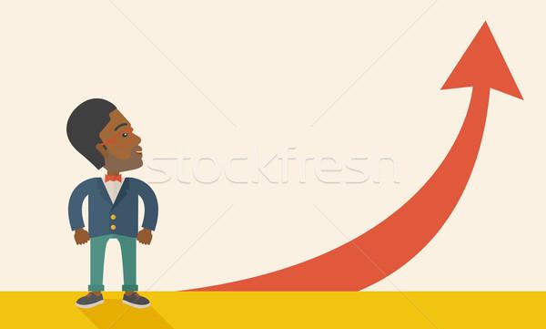 üzletember áll vmi mellett piros nyíl mutat Stock fotó © RAStudio