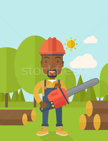 Black Lumberjack cuts a tree by chainsaw. Stock photo © RAStudio