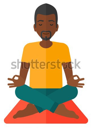 Man meditating in lotus pose. Stock photo © RAStudio