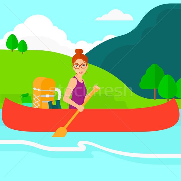 Woman canoeing on the river. Stock photo © RAStudio