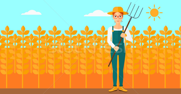 Farmer with pitchfork. Stock photo © RAStudio