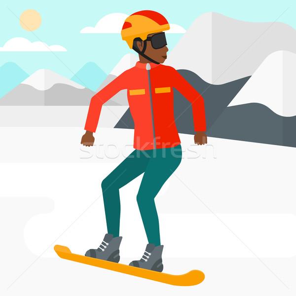 Young woman snowboarding. Stock photo © RAStudio