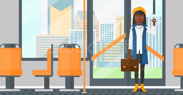 Vrouw permanente binnenkant openbaar vervoer koffer vector Stockfoto © RAStudio