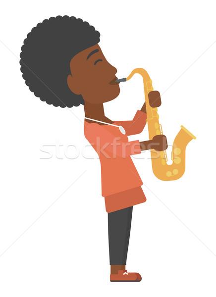 Woman playing saxophone. Stock photo © RAStudio