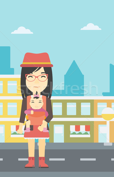 Mother carrying her daughter in sling. Stock photo © RAStudio