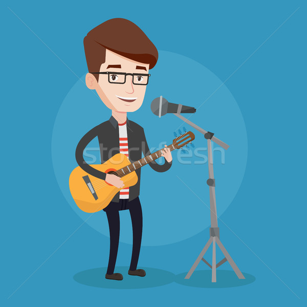 Man singing in microphone and playing guitar. Stock photo © RAStudio