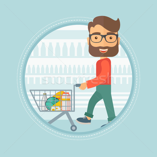 Customer walking in store with shopping trolley. Stock photo © RAStudio