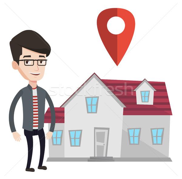 Emlâkçı ev harita genç gülen Stok fotoğraf © RAStudio
