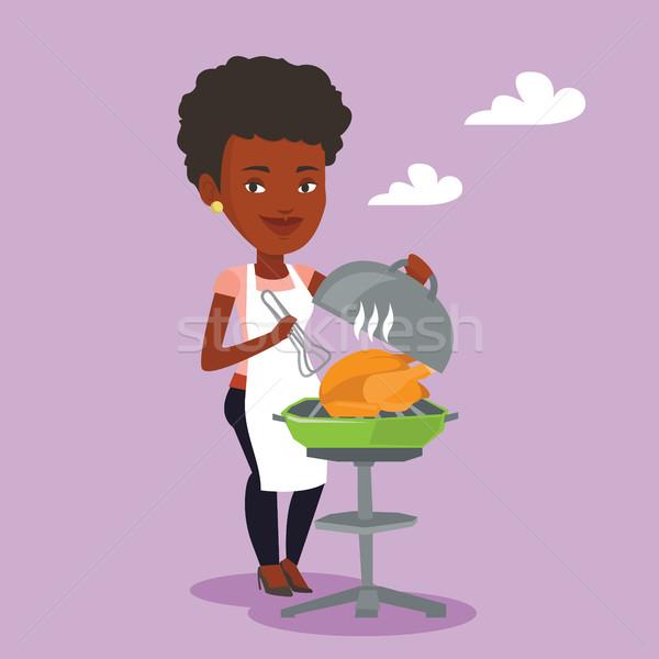 Nő főzés tyúk barbecue grill kint fiatal nő Stock fotó © RAStudio