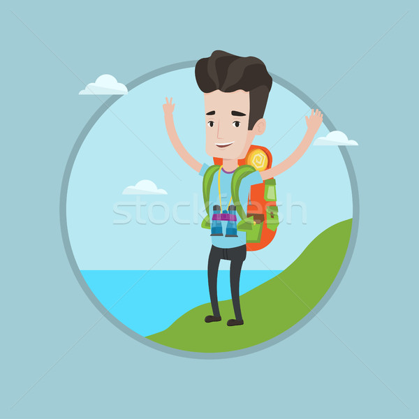 Backpacker with his hands up enjoying the scenery. Stock photo © RAStudio