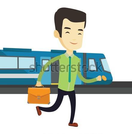 Uomo d'affari stazione ferroviaria giovani asian piedi treno Foto d'archivio © RAStudio
