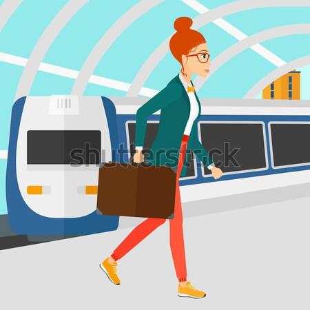 Femme d'affaires gare jeunes marche train plate-forme Photo stock © RAStudio