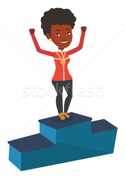 Zdjęcia stock: Sportsmenka · zwycięzcy · podium · młodych · złoty · medal