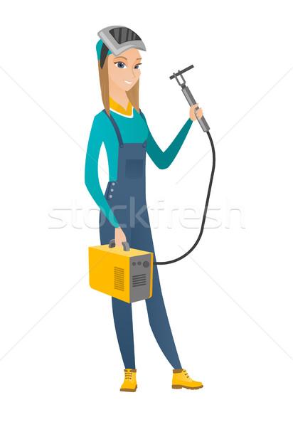 Welder holding gas welding machine. Stock photo © RAStudio