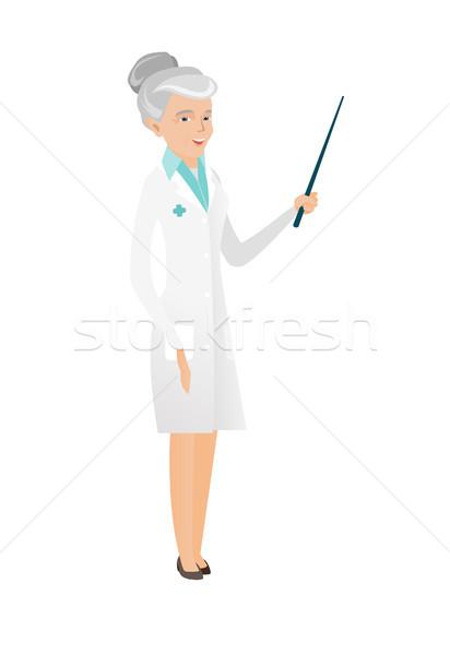 Senior caucasian doctor holding pointer stick. Stock photo © RAStudio