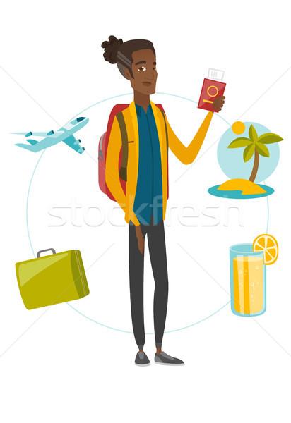 молодые африканских путешественник паспорта билета Сток-фото © RAStudio
