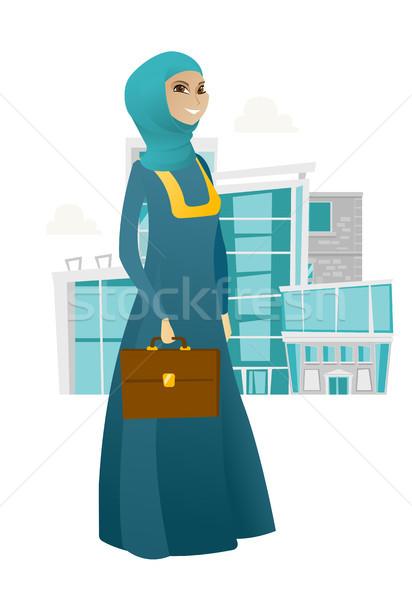 Muslim business woman holding briefcase. Stock photo © RAStudio