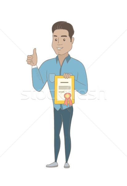 Young hispanic businessman holding a certificate. Stock photo © RAStudio