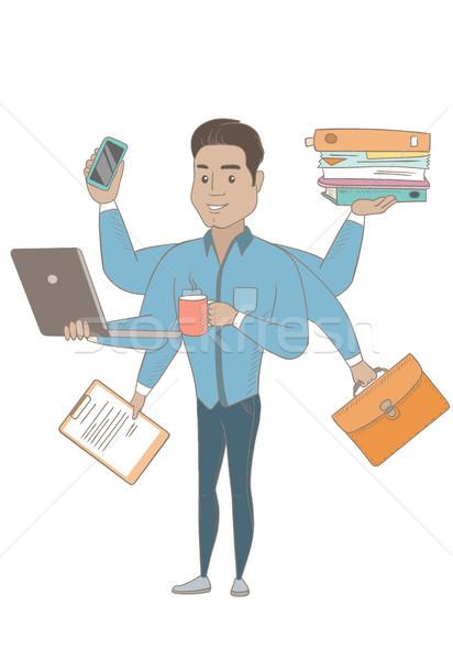 Hispanic businessman coping with multitasking. Stock photo © RAStudio