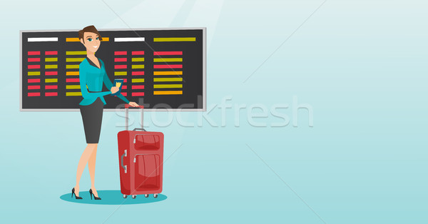 Caucasian airplane passenger holding passport. Stock photo © RAStudio