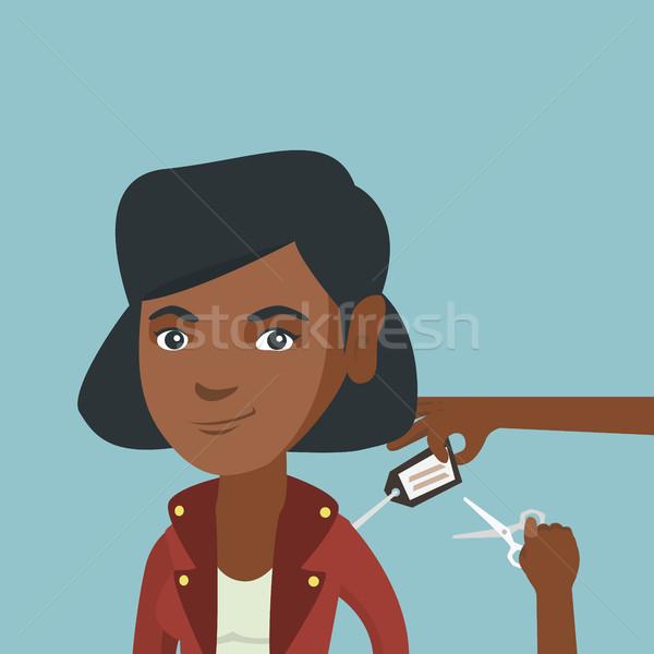 African woman cutting price tag off new jacket. Stock photo © RAStudio