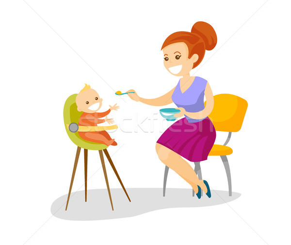 Young caucasian white mother feeding her baby. Stock photo © RAStudio