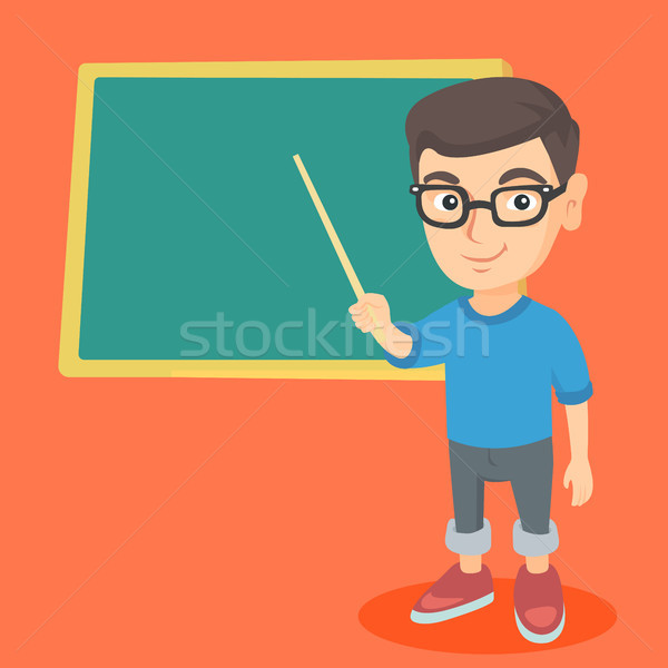 Caucasian student pointing at the blackboard. Stock photo © RAStudio