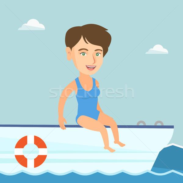 Young caucasian woman tanning on a sailboat. Stock photo © RAStudio