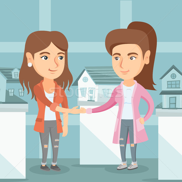 Real estate agent and client shaking hands. Stock photo © RAStudio