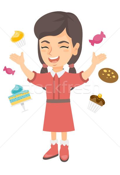 Happy caucasian girl standing among lots of sweets Stock photo © RAStudio